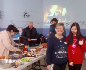 Photo 29 – special thanks to Angela – ASDA Activities Coordinator for continued support with setting up and providing party/buffet food etc. Photo includes, Lauranne, Charlotte, John and Gary who all enjoyed this year's Christmas Party and helped with setting up and clearing away!